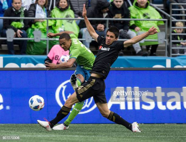 Henry Wingo of the Seattle Sounders passes the ball as Moutinho Joao of Los Angeles FC defends during the first half of a match at CenturyLink Field...