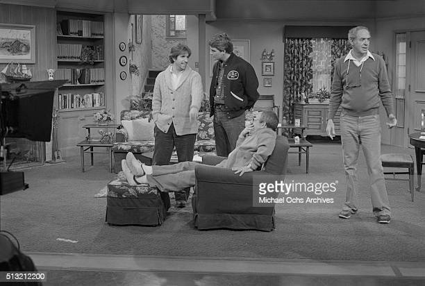 Henry Winkler Ted McGinley and Tom Bosley rehearse on the set of 'Happy Days' at Paramount Studios on March 5 1981 in Los Angeles California