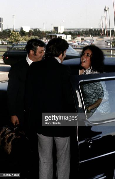 Henry Wynberg and Elizabeth Taylor during Elizabeth Taylor and Henry Wynberg Sighting New York City August 1 1974 at JFK Airport in New York City New...