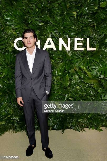 Henry Zaga attends Chanel Dinner Celebrating Gabrielle Chanel Essence With Margot Robbie on September 12 2019 in Los Angeles California