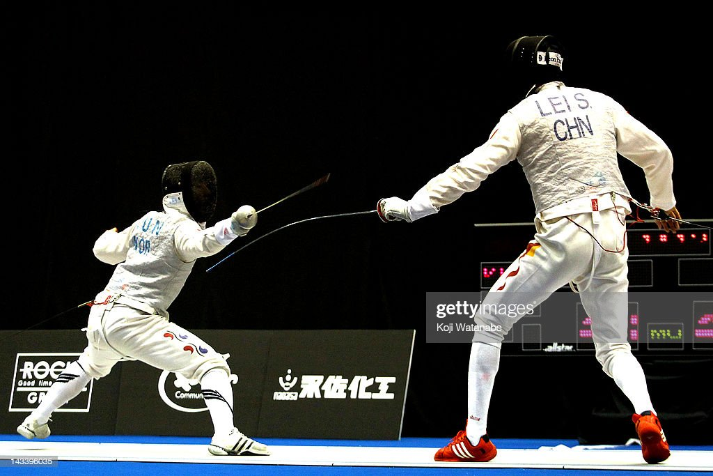 Heo Jun of South Korea competes againsti Lei Sheng of China in the Men's Foil Team Tableau final on day four of the 2012 Asian Fencing Championships at Wakayama Big Wave on April 25, 2012 in Wakayama, Japan.