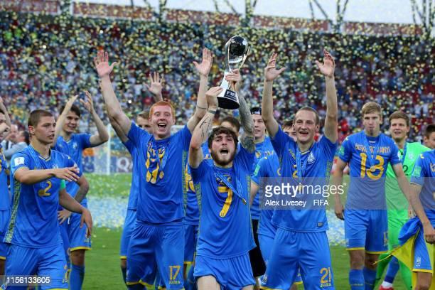 Heorhii Tsitaishvili of Ukraine celebrates with the trophy following victory in the 2019 FIFA U20 World Cup Final between Ukraine and Korea Republic...