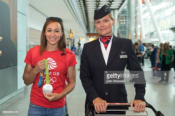 Hepathlete Jessica EnnisHill of Great Britain poses with her Silver Medal after arriving on a British Airways flight from Rio de Janeiro in Brazil to...