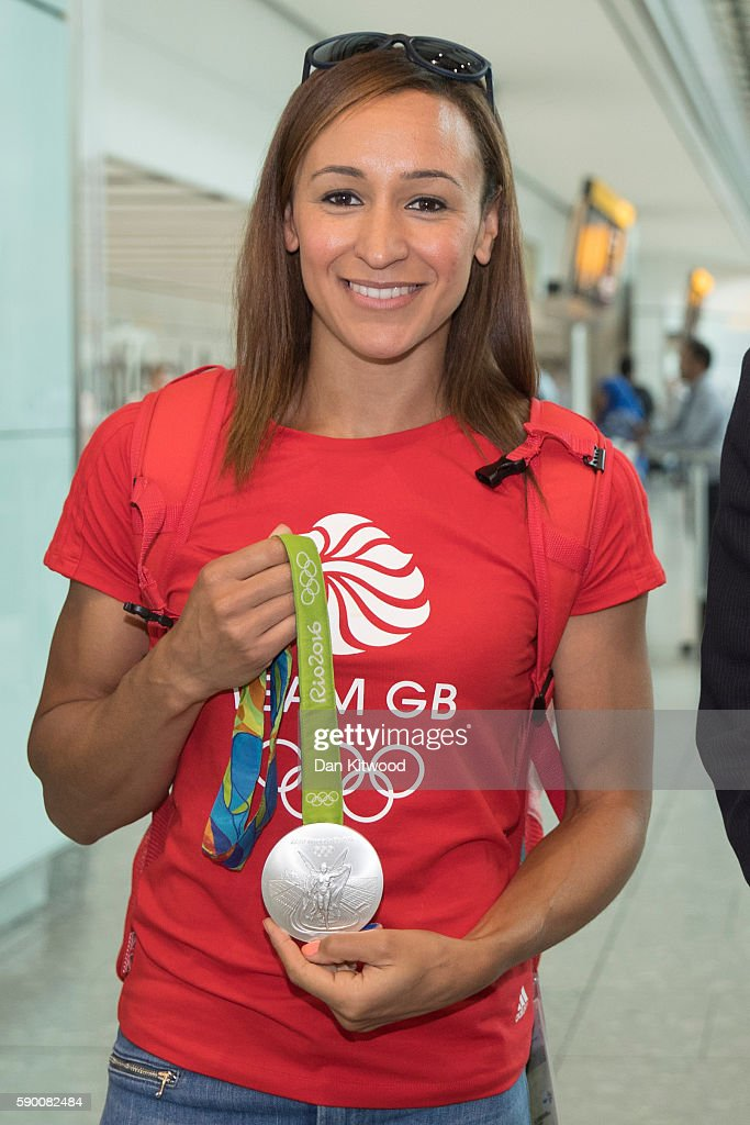 Hepathlete Jessica Ennis-Hill of Great Britain poses with her Silver Medal after arriving on a British Airways flight from Rio de Janeiro in Brazil to London Heathrow Airport's Terminal 5 on August 16, 2016 in London, England. Jessica Ennis-Hill won her Silver medal in the heptathlon at the 2016 Rio Olympic Games.