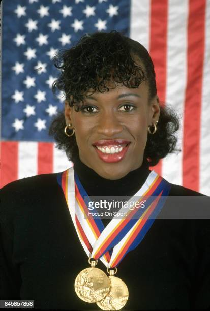 Heptathlete Jackie JoynerKersee of the United States poses with her gold metals from winning the Heptathlon event at the Games of the XXIV Olympiad...