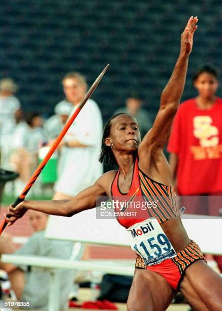 Heptathlete Jackie JoynerKersee throws the javelin 15 June during the US Track and Field trials in Atlanta Kersee continues to lead the event