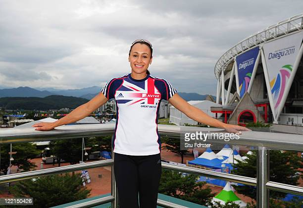 Heptathlete Jessica Ennis of Great Britain poses in front of the stadium as she attends a press conference at the adidas PR lounge prior to to the...