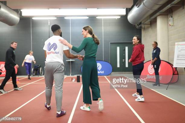 Heptathlete Jessica Ennis-Hill watches as para-athlete sprinter Emmanuel Oyinbo-Coker shakes hands with the Duchess of Cambridge following a short...