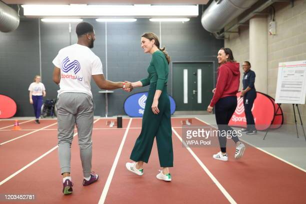Heptathlete Jessica EnnisHill watches as paraathlete sprinter Emmanuel OyinboCoker shakes hands with the Duchess of Cambridge following a short...