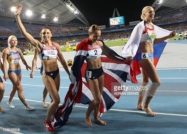 Heptathletes including gold medallist Russia's Tatyana Chernova and silver medallist Britain's Jessica Ennis take a lap of honour following the...