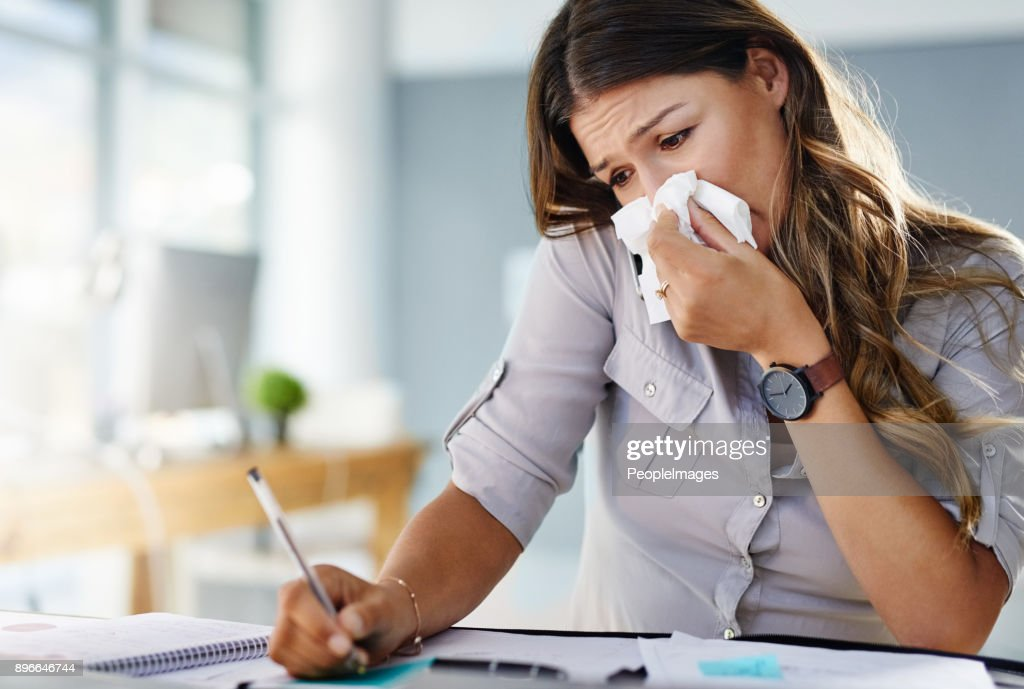 Her allergies are keeping her from being productive : Stock Photo