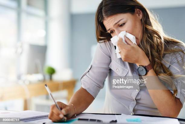 her allergies are keeping her from being productive - cold virus stock pictures, royalty-free photos & images