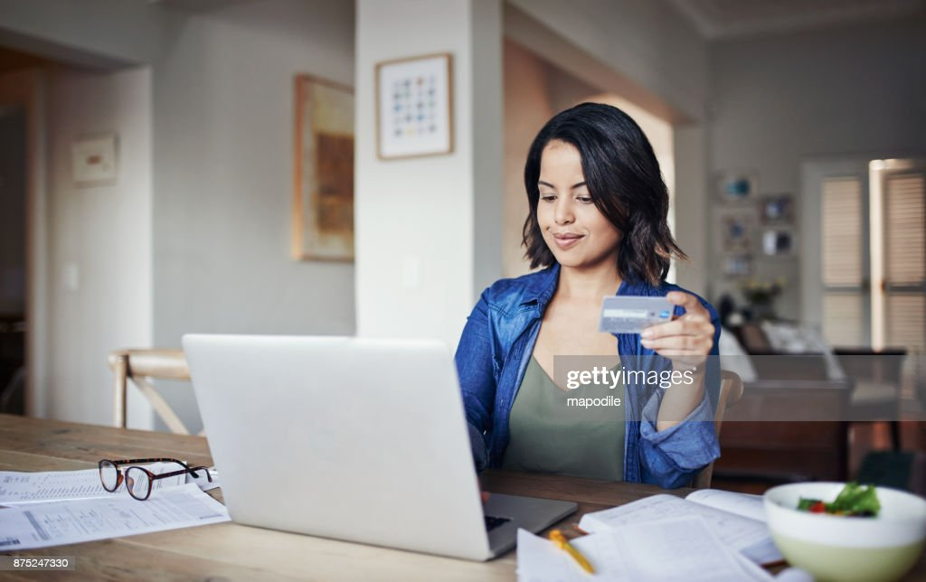 Her bills are always paid on time : Stock Photo