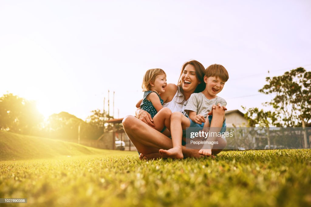Her boys fill her life with joy : Stock Photo