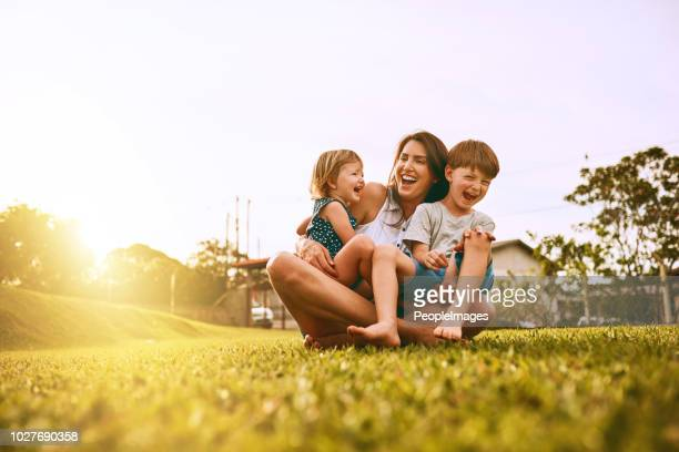 her boys fill her life with joy - son stock pictures, royalty-free photos & images