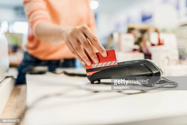 her credit card's got her shopping covered - cash register stock pictures, royalty-free photos & images