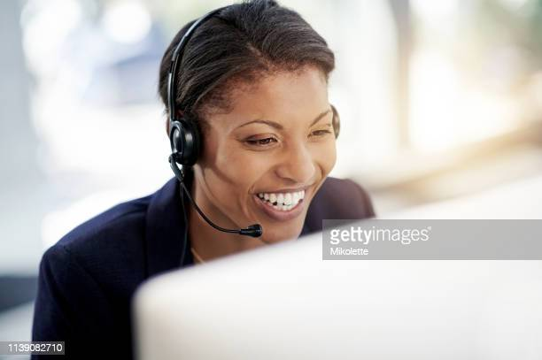 her customer's love that she loves her job - headset stock pictures, royalty-free photos & images