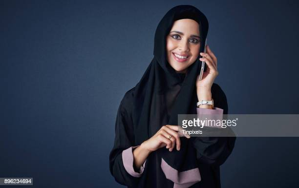 her direct line to happiness - muslim woman darkness stock photos and pictures