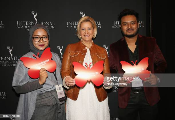 Her Excellency Lorena Castillo De Varela First Lady of the Republic of Panama poses with YCA Winners Puti Puar and Raj Dutta during the Young...