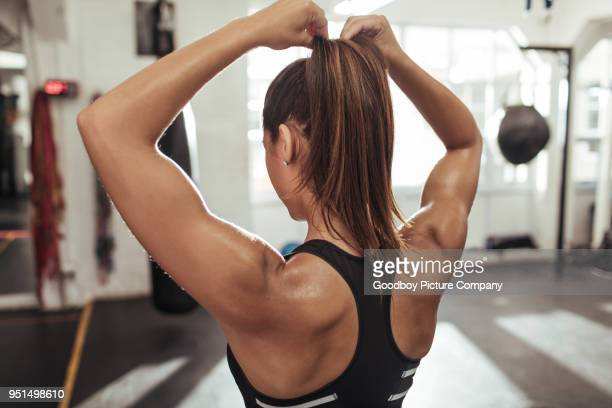 her hair can get in the way of her workout - human back stock pictures, royalty-free photos & images