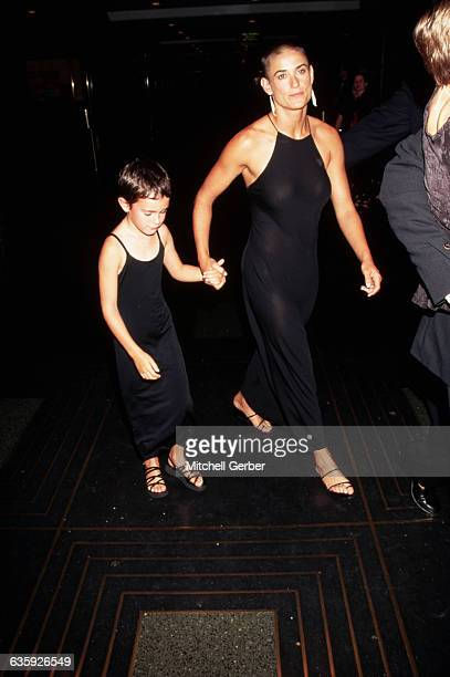 Her head still shaved from her role in GI Jane Demi Moore attends the premiere of Striptease with her daughter Rumer Willis