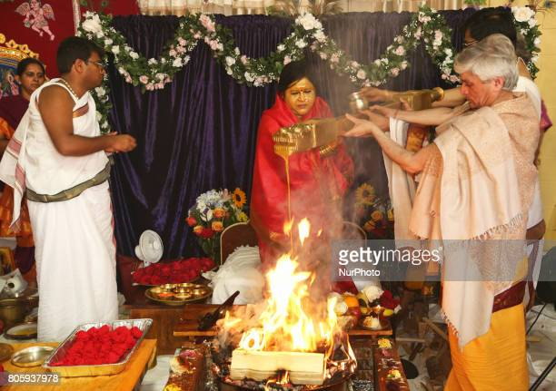 Her Holiness Amma Sri Karunamayi along with Hindu priests perform special prayers during the Homa at the Bhuvaneswari Amman Temple in Brampton...