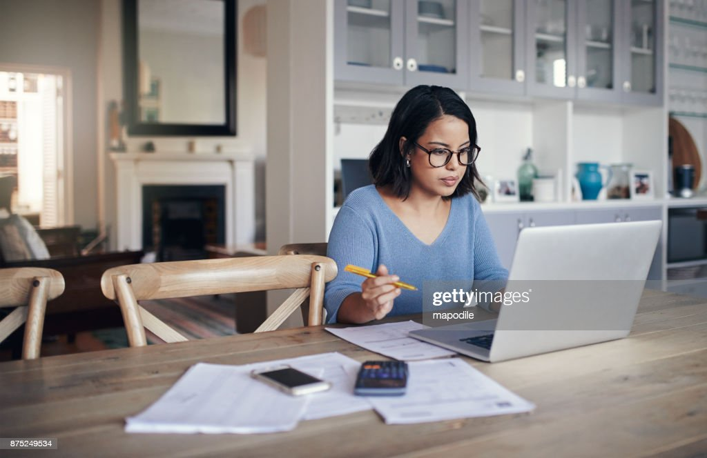 Her home is a place for productivity : Stock Photo
