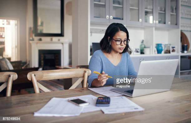 her home is a place for productivity - using computer stock photos and pictures