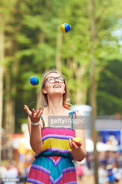 her juggling skills are on the ball - juggling stock pictures, royalty-free photos & images