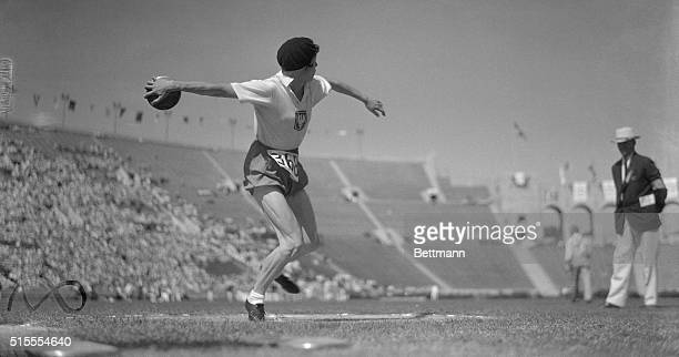Her leg muscles standing out like steel cables, Stella Walsh, representing Poland, tightens up to heave the discus during the event in the Los...