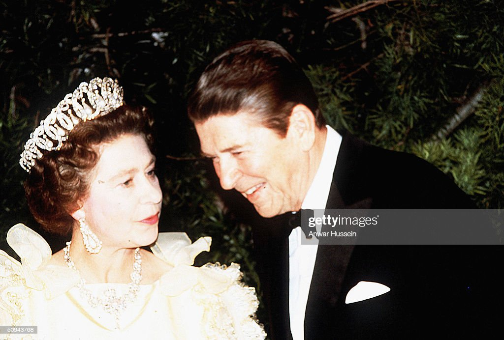 Her Majesty Queen Elizabeth II and President Ronald Reagan share a joke during a banquet in March 1983 in San Francisco, California.