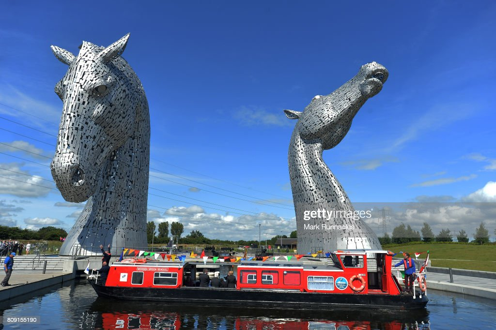 Her Majesty Queen Elizabeth II and Prince Philip, Duke of Edinburgh arrive on a canal boat at the Kelpies on July 5, 2017 in Falkirk, Scotland. Queen Elizabeth II and Prince Philip, Duke of Edinburgh visited the new section the Queen Elizabeth II Canal, built as part of the £43m Helix project which features the internationally-acclaimed, 30-metre-high Kelpies sculptures.