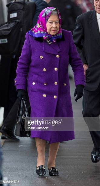 Her Majesty Queen Elizabeth II arrives at King's Lynn Station on December 21, 2017 in King's Lynn, England ahead of her Christmas break at...