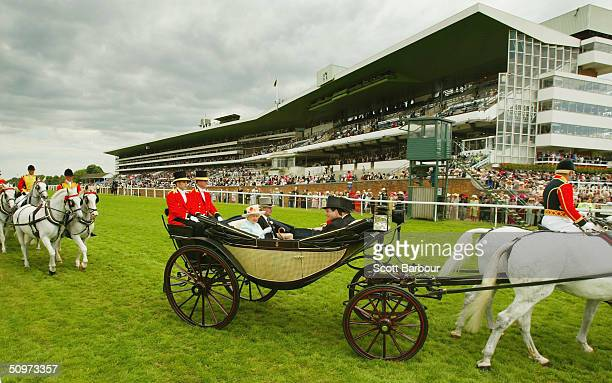 Her Majesty Queen Elizabeth II arrives in a horsedrawn carriage on the fourth day of Royal Ascot at Ascot Racecourse on June 18 2004 in Berkshire...
