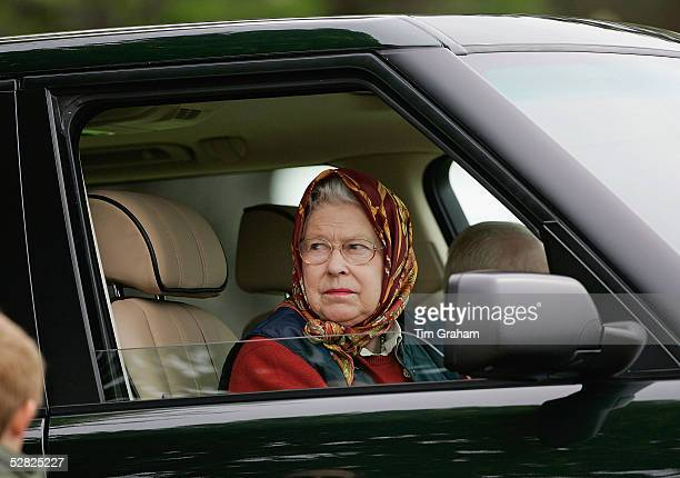 Her Majesty Queen Elizabeth II drives her Range Rover at the Royal Windsor Horse Show in the grounds of Windsor Castle on May 14 2005 in Windsor...