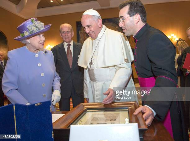 Her Majesty Queen Elizabeth II exchanges gifts with His Holiness Pope Francis during an audience in the Pope's study inside the Paul VI Hall on her...