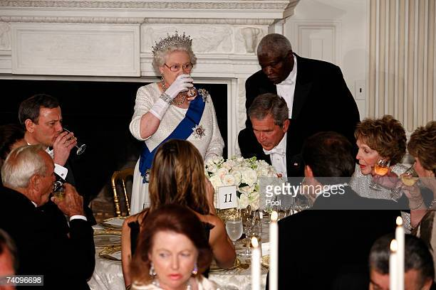 Her Majesty Queen Elizabeth II offers a toast to U.S. President George W. Bush and those gathered in the State Dining Room during a formal white-tie...