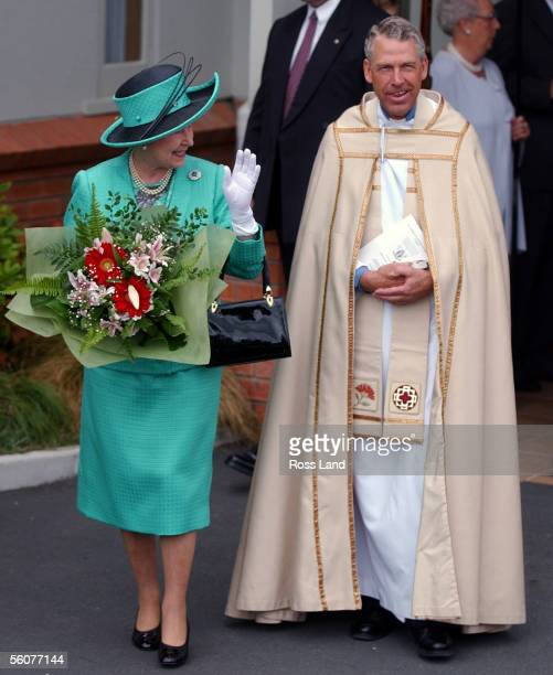 Her Majesty Queen Elizabeth II smiles at waiting fans as she walks with Reverend Geoff Hickman Vicar of St Andrews after she and the Duke Of...