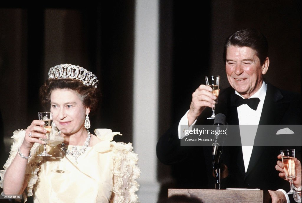 Her Majesty Queen Elizabeth II, wearing tiara and diamonds, makes a toast with former US President Ronald Reagan at a banquet in 1983, inSan Francisco, USA.