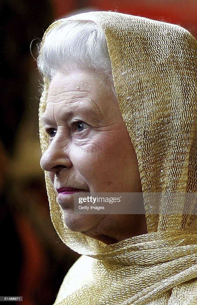 Her Majesty Queen Elizabeth is pictured wearing a head scarf during a visit to the Sikh Temple, Gurdwara Sri Guru Singh Sabha, on October 15, 2004 in Hounslow, London. The Queen and the Duke of Edinburgh attended to open phase two of the development.
