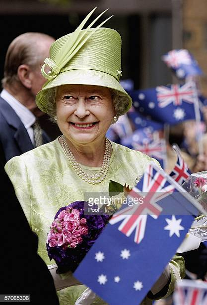 Her Majesty Queen Elizabeth ll smiles after she received flowers from the crowd after the Commonwealth Day Service March 13 2006 in Sydney Australia...
