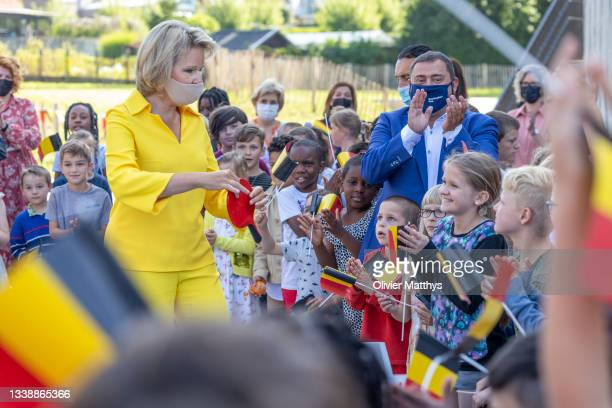 """Her Majesty Queen Mathilde of Belgium practices her table tennis skills with the pupils during a visit to the KAZ """"Koninklijk Atheneum Zottegem""""..."""
