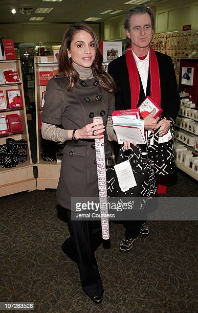 Her Majesty Queen Rania Al Abdullah of Jordan and RED CoFounder Bobby Shriver make an appearence at the LeMarc's Hallmark Gold Crown Store on October...