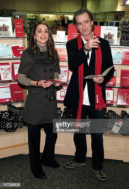 Her Majesty Queen Rania Al Abdullah of Jordan and RED Co-Founder Bobby Shriver make an appearence at the LeMarc's Hallmark Gold Crown Store on...