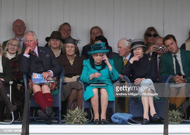 Her Majesty the Queen alongside the Duke of Rothesay Prince Charles as he is known in Scotland with the Princess Royal at the Braemar Royal Highland...
