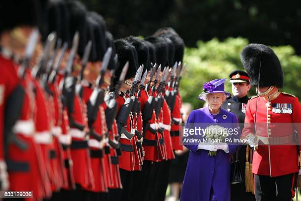 Her Majesty the Queen inspects the guard of honour as she attends the ceremony of the keys at the palace of Holyroodhouse Edinburgh