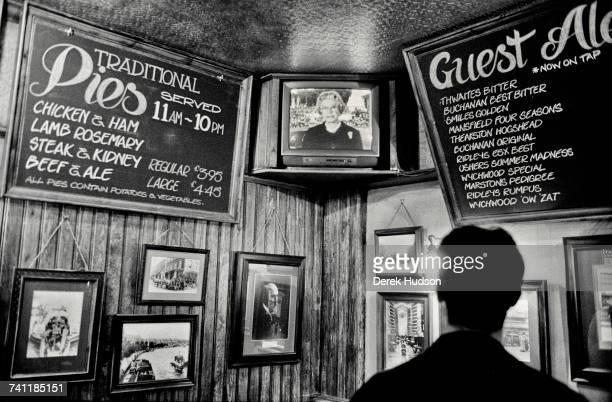 Her Majesty The Queen of England seen making an announcement on a television inside a London pub during the public funeral of Diana Princess of Wales...