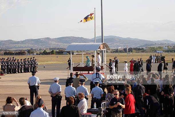 Her Majesty The Queen receives the salute on arrival in Canberra at Defence Establishment Fairbairn on October 19, 2011 in Canberra, Australia. The...