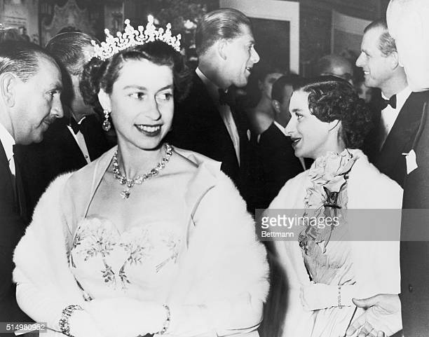 Her Majesty the Queen with Princess Margaret and the Duke of Edinburgh at Tivoli Theater. The Duke is conversing with Lord Harewood.