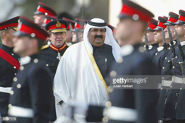 Her Majesty The Queen's Representative His Highness Sheikh Hamad bin Khalifa Al-Thani, The Emir of Qatar inspects soldiers during the 144th...